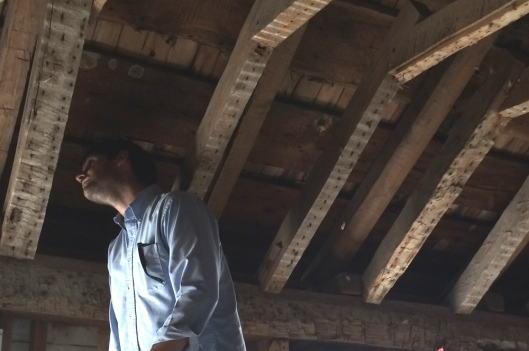 Ed Barnes of Atlantic Heritage examines the frame for surviving evidence of the original 18th century roof system. The original hipped roof was replaced by the existing gable roof in the early 19th century which drastically altered the appearance of the house.